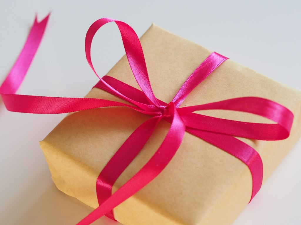 gift box wrapped in pink ribbon. Where to buy gifts and presents in Graz.
